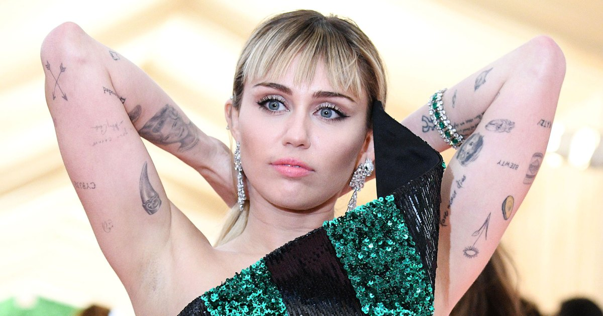 Miley Cyrus Tattoos Guide To All Her Ink And Their Meanings