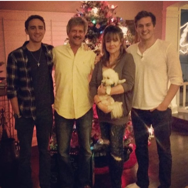 Peter Weber With His Dog and Family by the Christmas Tree