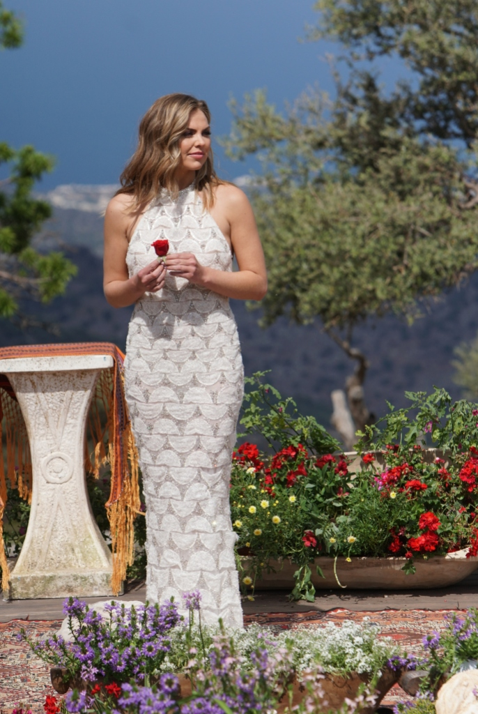 Hannah Brown Wears a White Gown While Holding a Rose During Bachelorette Season 15 Finale