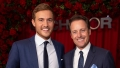 Chris Harrison and PEter Weber Smile While Holding a Rose
