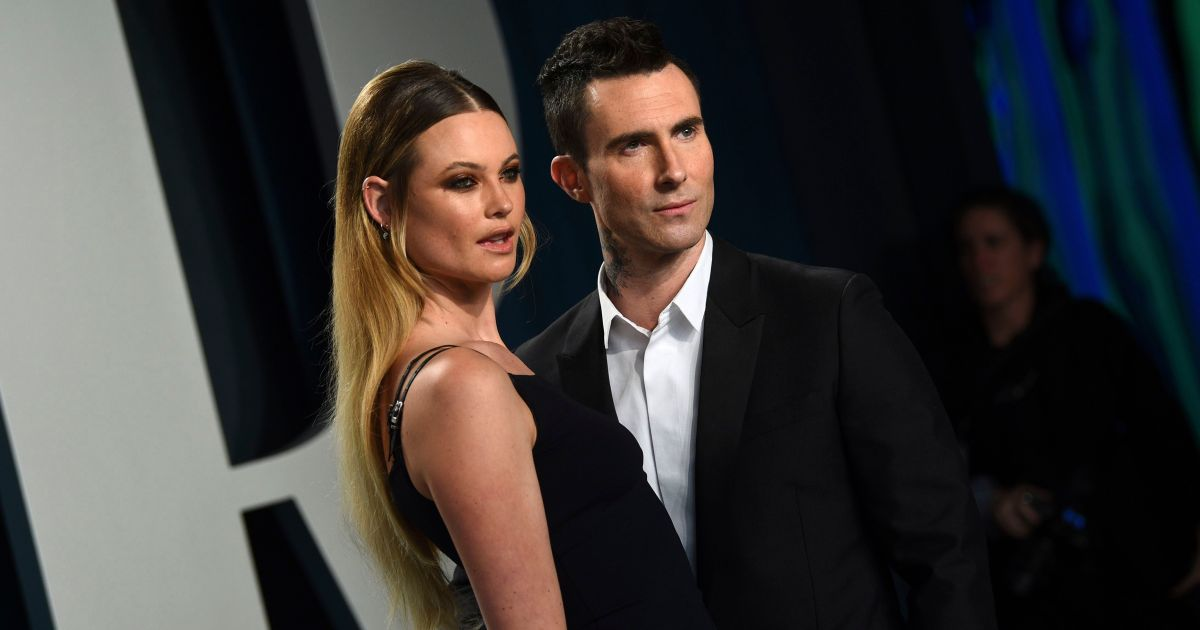 Adam Levine and Behati Prinsloo Share a Steamy Kiss at Oscars Afterparty