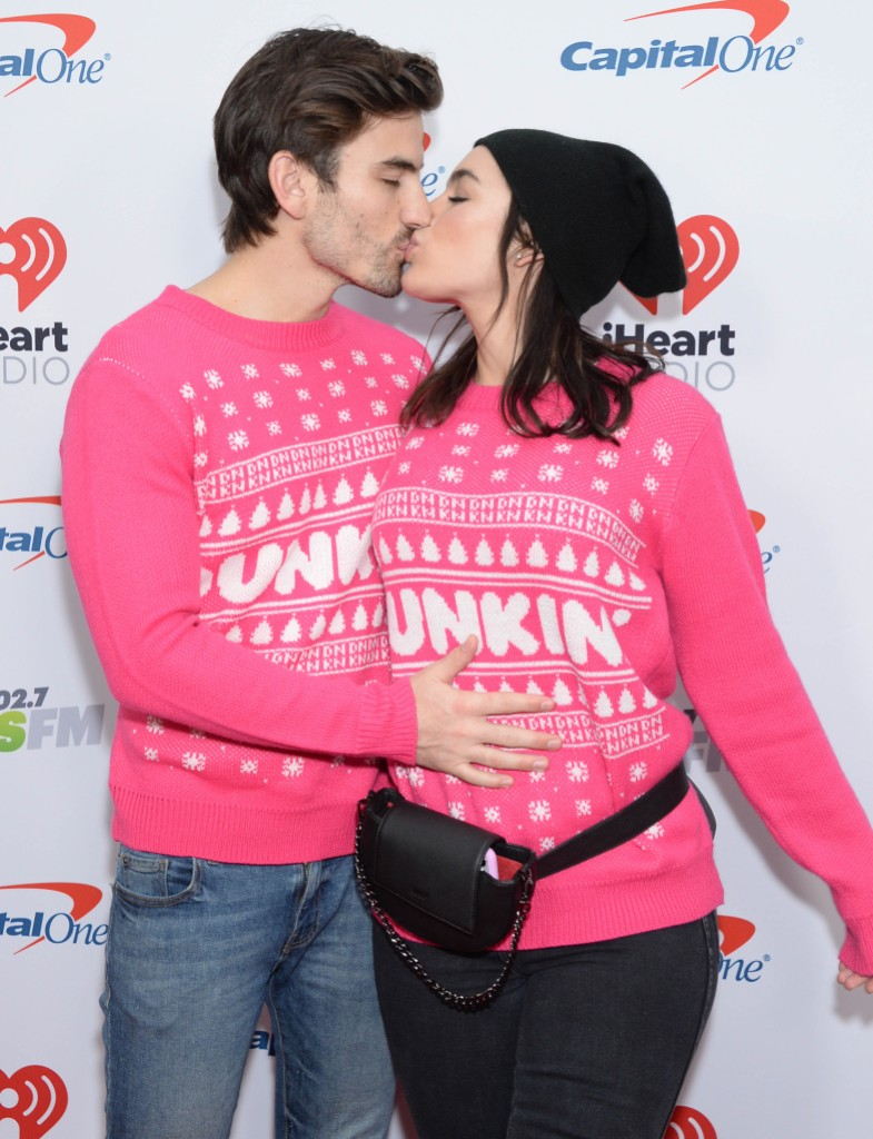 Ashley Iaconetti and Jared Haibon Wearing Pink Sweaters and Kissing