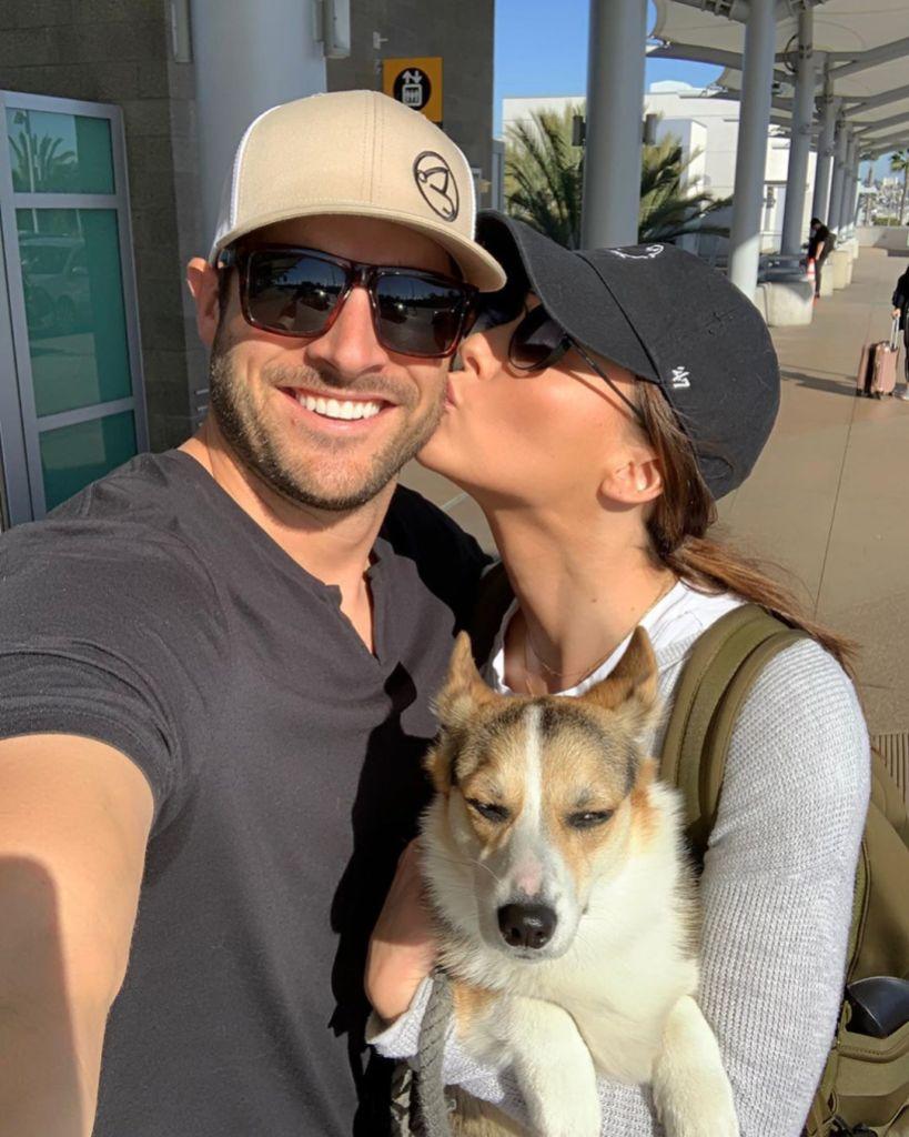 Becca Kufrin Kissing Garrett With Their Dog
