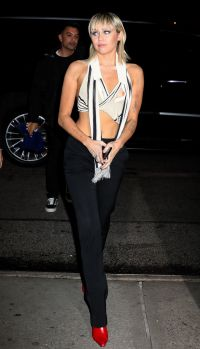 Miley Cyrus After Marc Jacobs Show in Black and White Crop Top Black Pants and Red Boots NYFW With Blonde Mullet Hair Cut