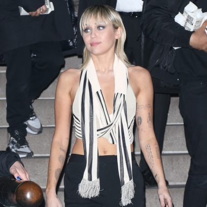 Miley Cyrus Wears Black and White Crop Top and Red Boots at Marc Jacobs Show During NYFW
