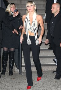 Miley Cyrus After Marc Jacobs Show in Black and White Crop Top Black Pants and Red Boots NYFW With Mullet Hair Cut