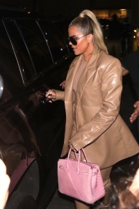 Khloe Kardashian Wears Brown Leather Suit With Pink Purse and Sunglasses