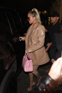 Khloe Kardashian Wears Brown Leather Suit With Pink Purse and Sunglasses Leaving Dinner