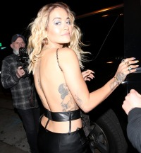 Rita Ora In Sheer Silver Top and Long Leather Skirt Back Tattoos