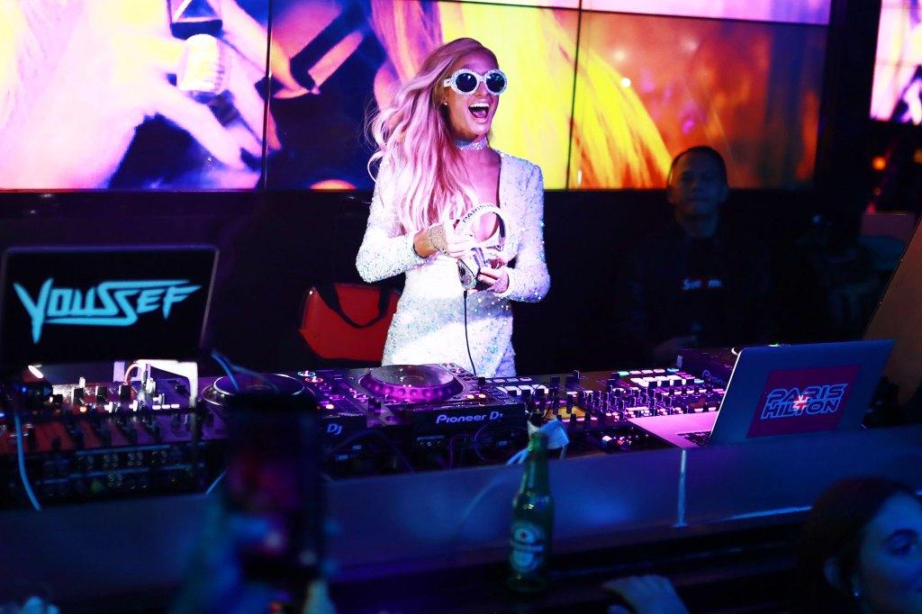Paris Hilton DJing at WALL