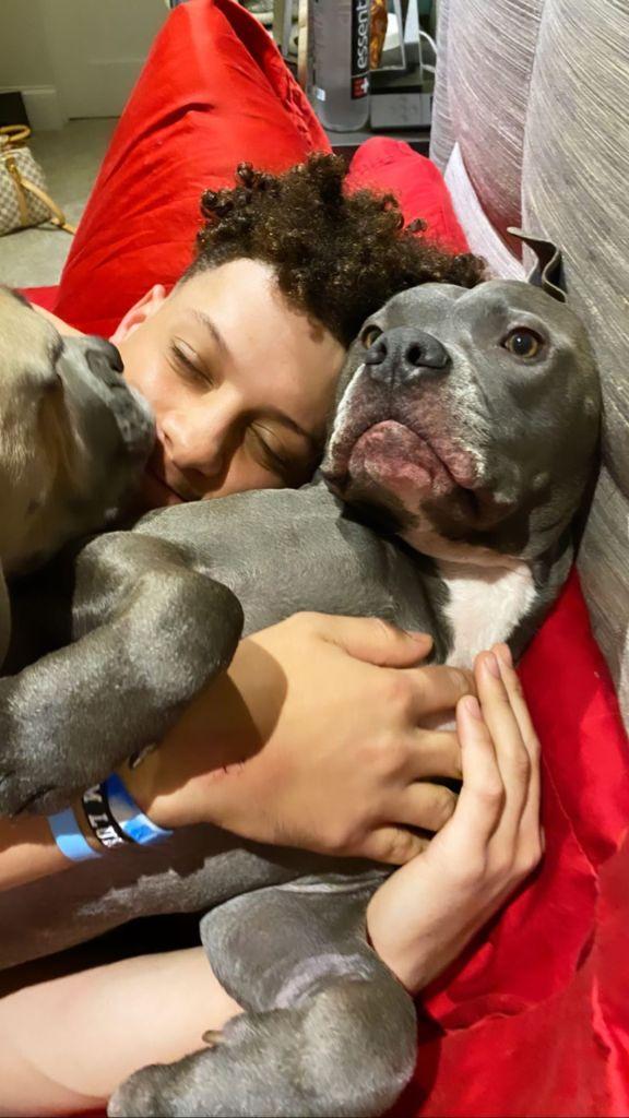 Austin Mahomes Cuddles Dog