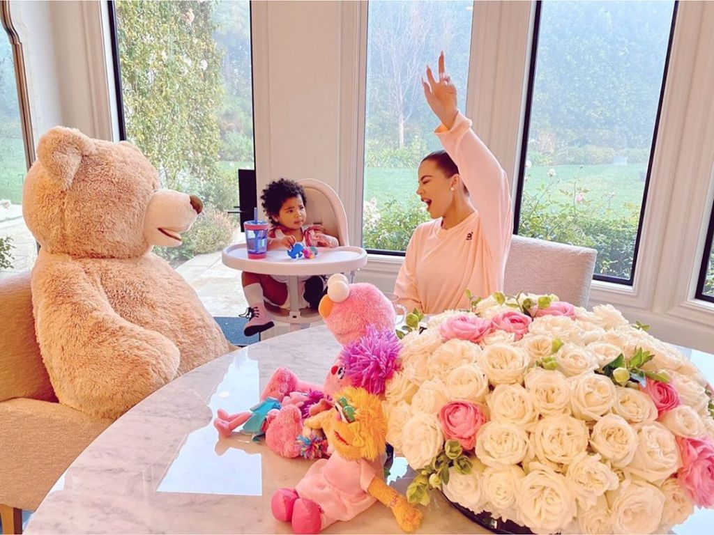 Khloe Kardashian Laughs and Gives Peace Sign While Spending the Morning With Daughter True Thompson in a High Chair
