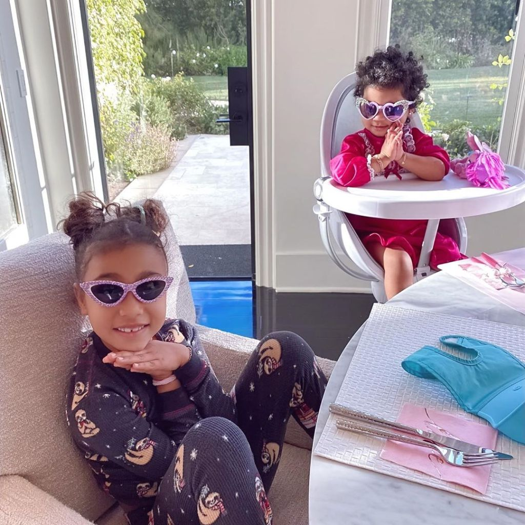 North West and Cousin True Thompson Wear Sunglasses While Praying at the Table