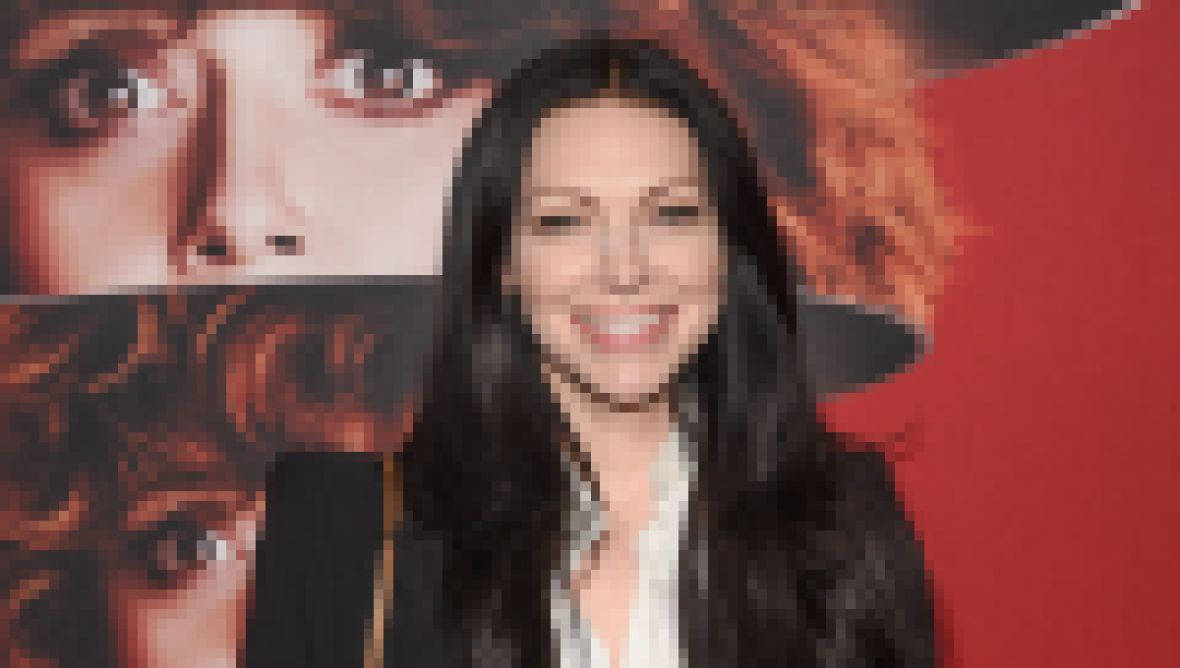 Laura Prepon Smiles in Black Suit With White Blouse