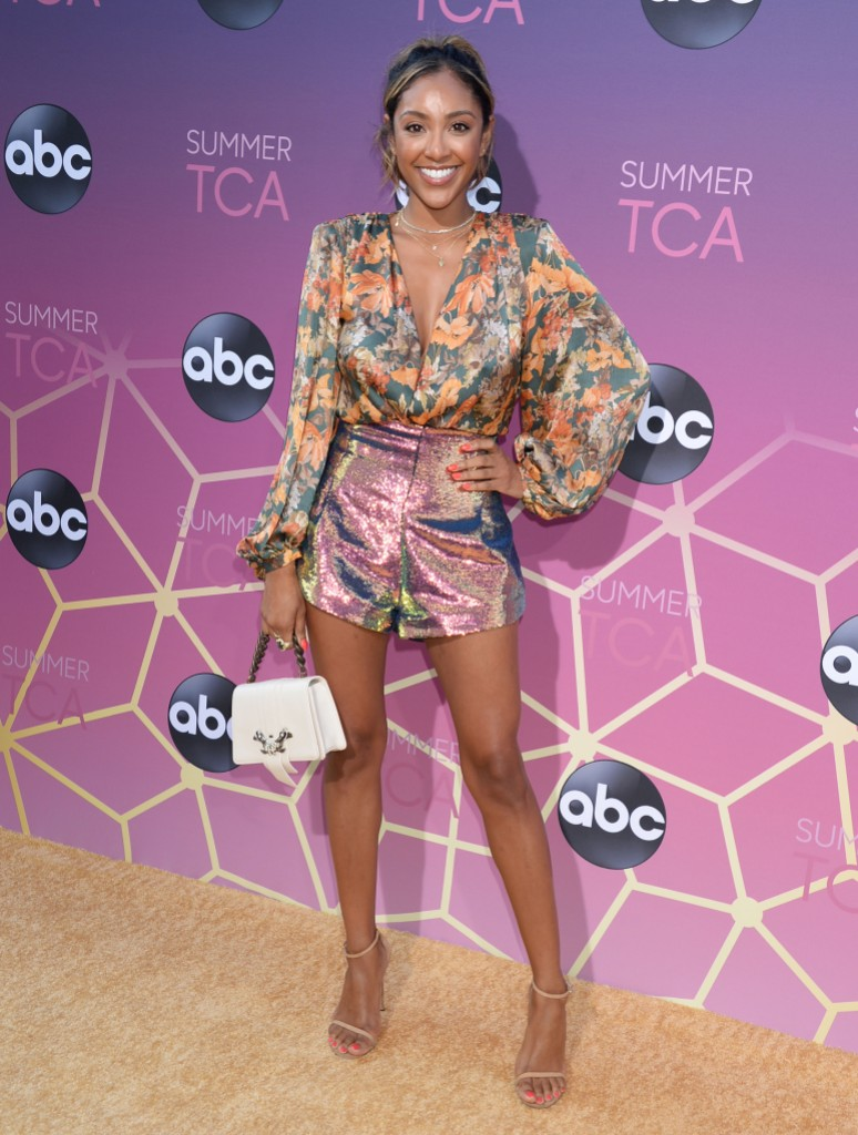 Bachelor in Paradise Contestant Tayshia Adams Smiles in Sequined Shorts and Flowered Top and Ponytail