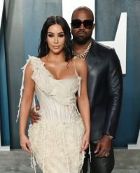 Kanye West Holds Wife Kim Kardashians Waist on Red Carpet for Vanity Fair Oscars party