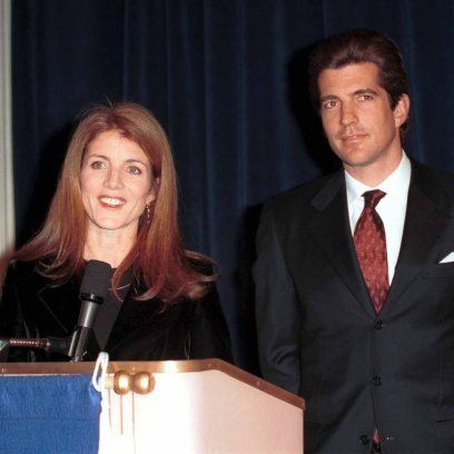 John F. Kennedy and CAROLINE KENNEDY Standing and Smiling Behind Podium