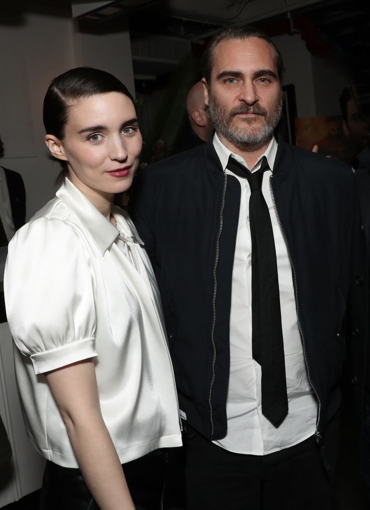 Joaquin Phoenix Wears a Suit With His Arm About Fiance Rooney Mara