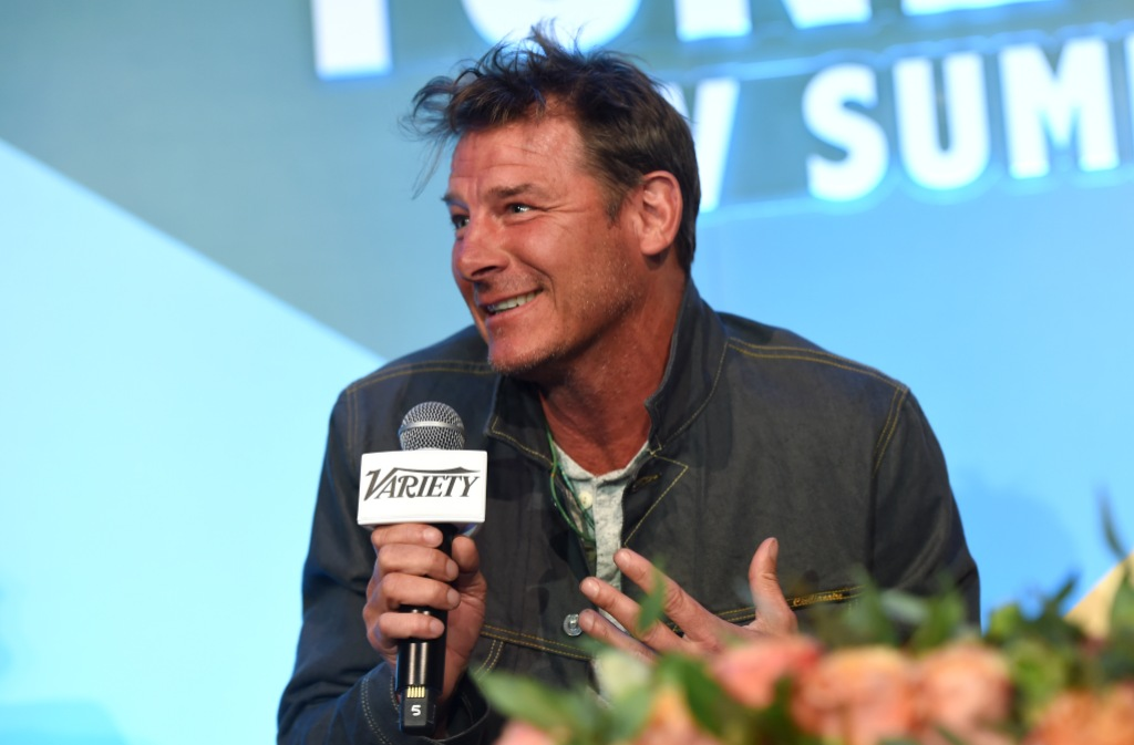 Ty Pennington Smiles Holding a Microphone