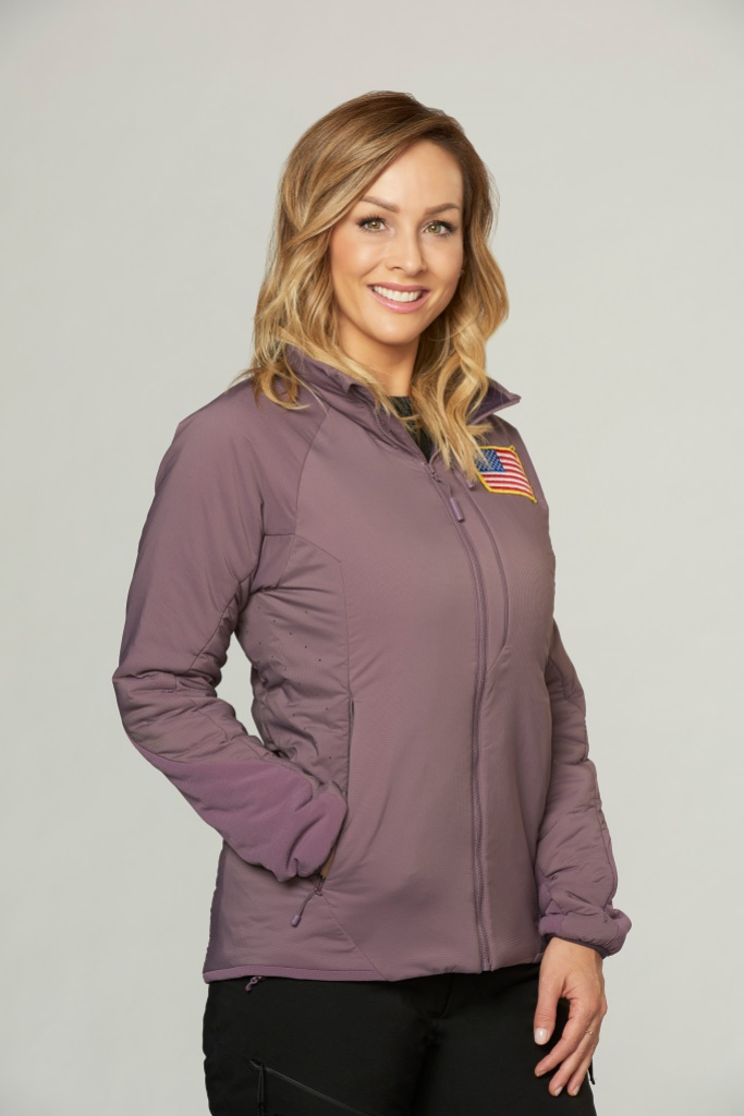 New Bachelorette Clare Crawley Smiles in Purple jacket With USA Flag on It