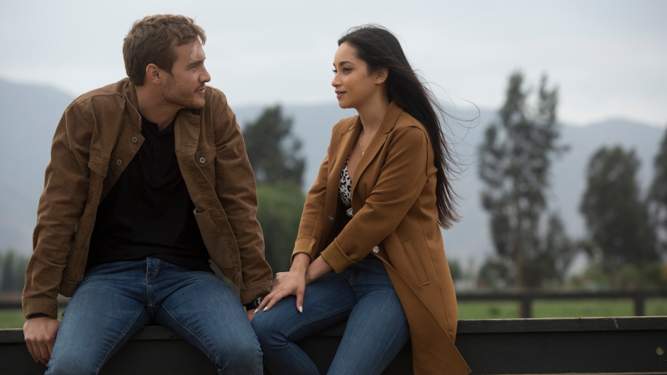 Bachelor peter Weber and Contestant Victoria Fuller Sit on a Fence