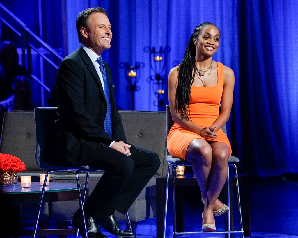 Bachelorette Rache Lindsay Wears Orange Dress and Long Braids Sitting With Chris Harrison in a Black Suit During Peter Weber's Women Tell All