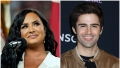 Demi Lovato Smiles Behind Microphone in a White Suit in Split Image With Actor Max Ehrich in Tan Jacket and Black Tshirt