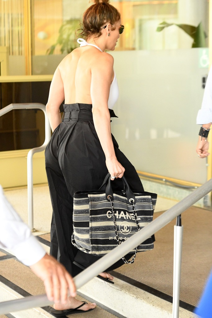 Jennifer Lopez shows off her back and a large Chanel bag as she heads out in Miami