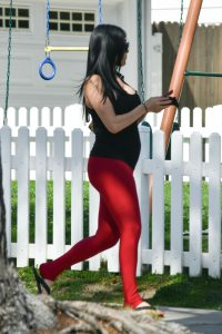 Nikki Bella Wears Red Workout Pants and Black Tank Top to Pure Barre Class