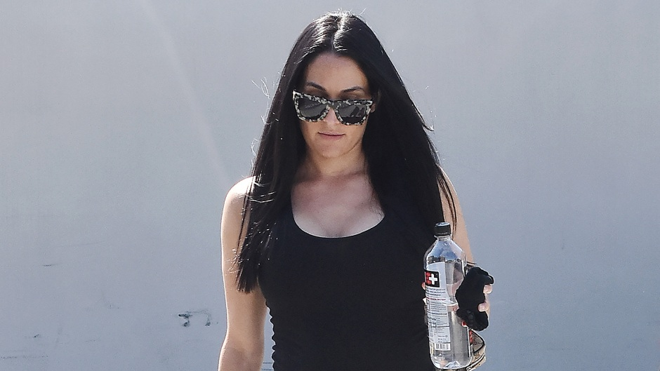 Nikki Bella Wears Red Workout Pants and TIght Black Tank Top While Walking Outside