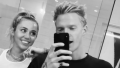 Miley Cyrus Smiles With Boyfriend Cody Simpson in Black and White Photo