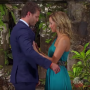 Bachelor Juan Pablo Galavis Stands in Blue Suit During Final Rose Ceremony With Contestant Clare Crawley in Teal One Shoulder Gown and She Pushes Him Back