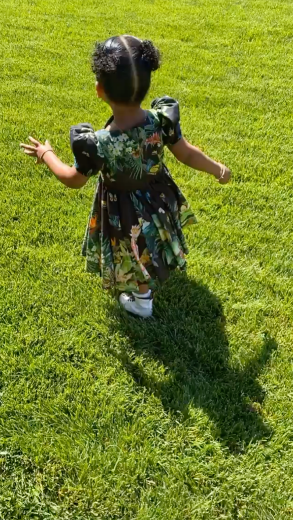 True Thompson Wearing a Floral Dress in Her Backyard