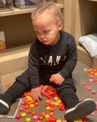 Ayesha and Stephen Curry Son Canon Sits with Starbursts