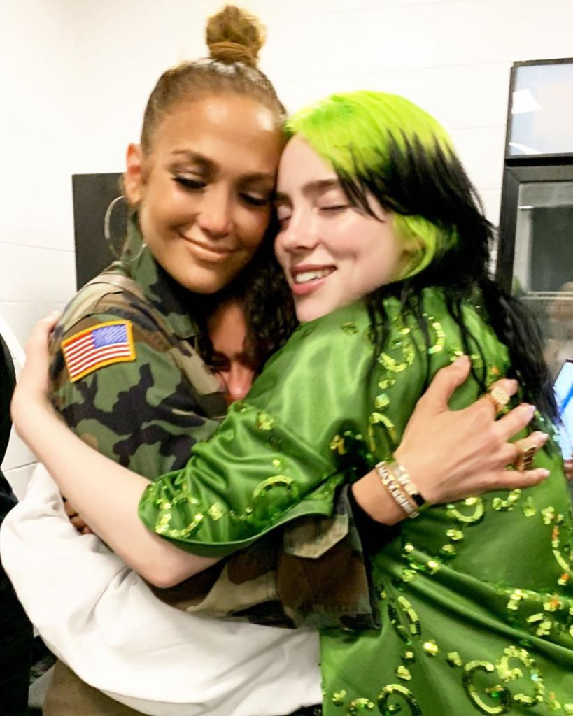 Billie Eilish Wears Green Outfit With Green and Black Hair While Hugging Jennifer Lopez and Daughter Emme