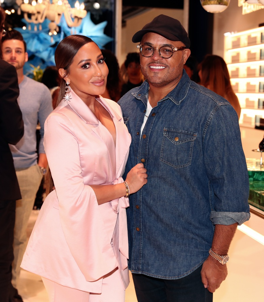 Adrienne Bailon Wears Pink Suit and Hugs Husband Israel Houghton in Jena Shirt and Black Hat
