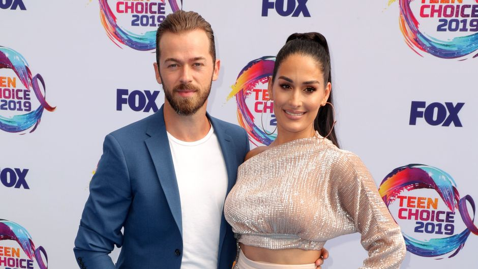 Nikki Bella Wears Sparkly Two Piece Outfit With Fiance Artem Chigvintsev in Blue Suit and White Tshirt
