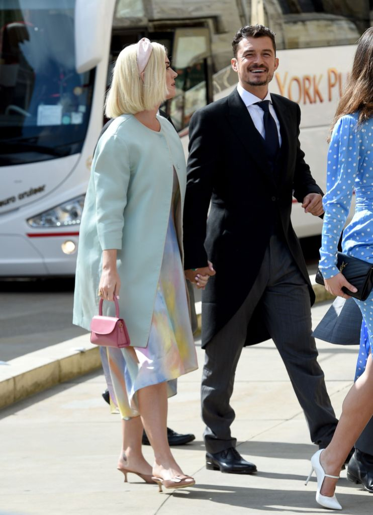 Katy Perry Wears Pastel Dress and Light Blue Overcoat With Orlando Bloom Black Suit