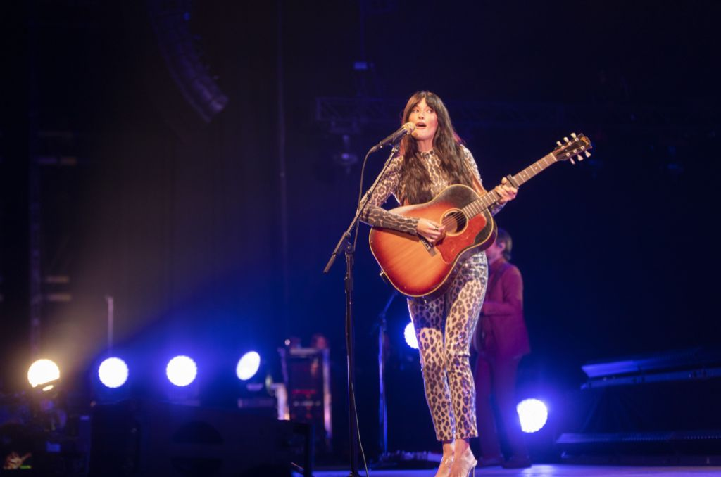 Kacey Musgraves Wears Jumpsuit While Playing Guitar on Stage