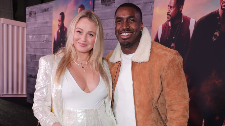 Pregnant Iskra Lawrence Wears White Jumpsuit With Boyfriend Philip Payne in Brown Suede Jacket