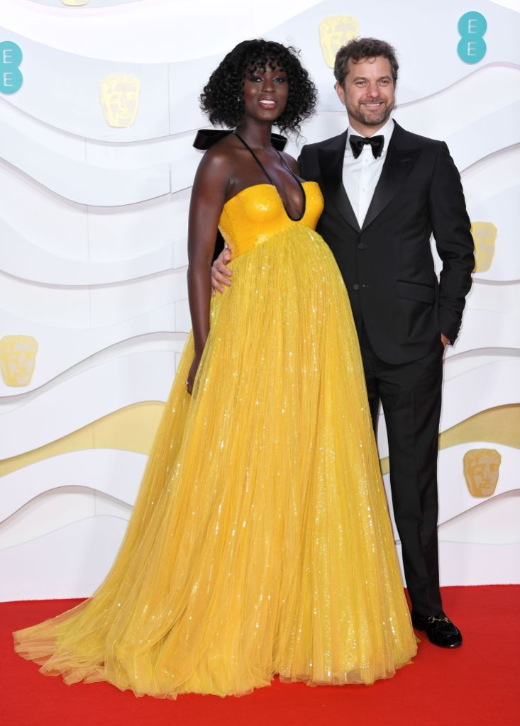 Jodie Turner Smith Shows Baby Bump in Yellow Gown With Husband Joshua Jackson