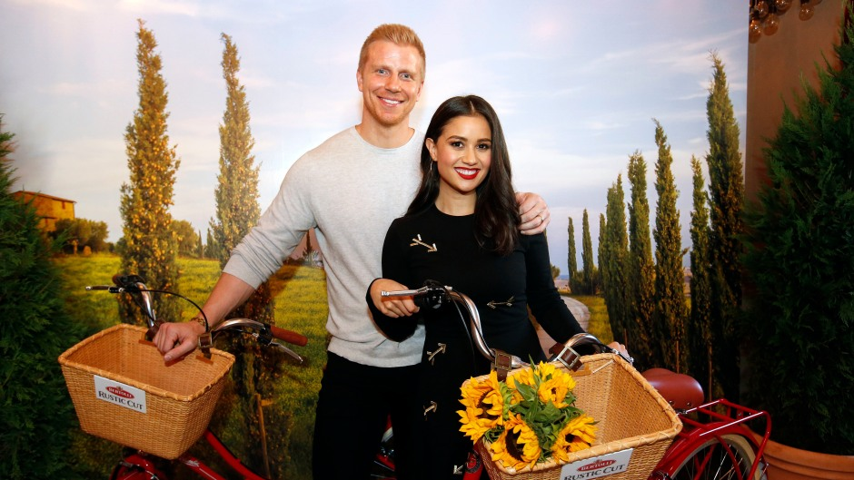 Bachelor Star Sean Lowe Smiles in Grey Sweater With Wife Catherine Holding Bikies