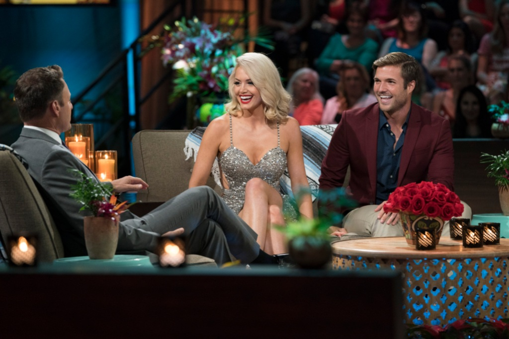 Bachelor in Paradise Aftershow Jordan Kimball Wears Red Suit and Sits By Jenna Cooper in Silver Dress Talking With Chris Harrison