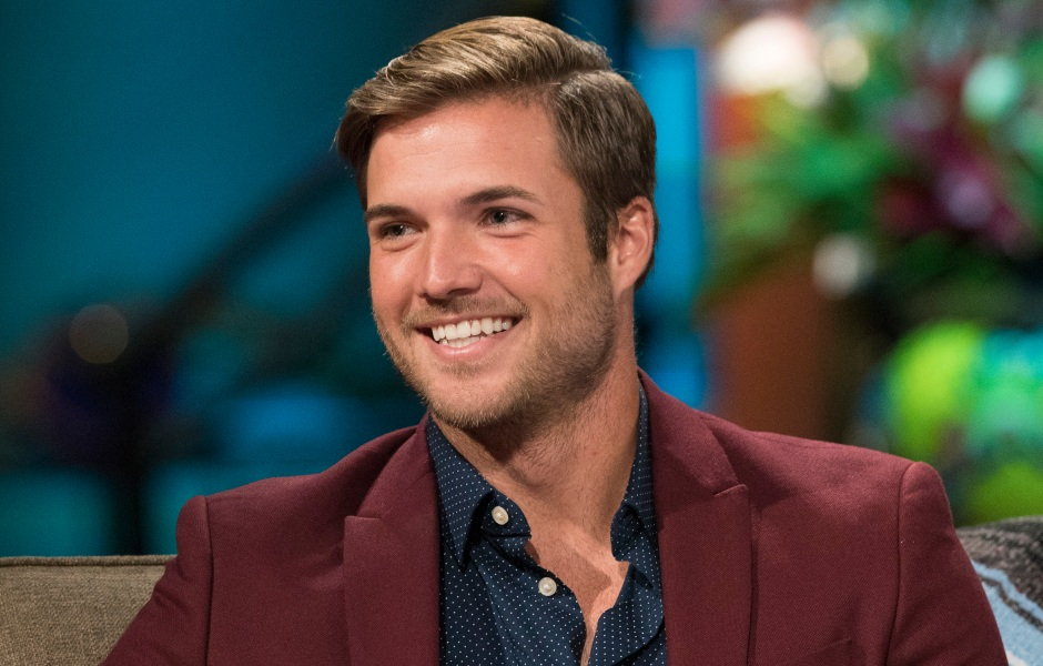 Bachelor in Paradise alum Jordan Kimball Wears Maroon Shirt and Blue Shirt While Smiling