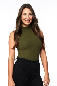 Bachelor Contestant Kelley Flanagan Headshot in Green Turtleneck and Black Jeans