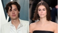 Cole Sprouse Wears White Silk Shirt and White Blazer and Vanity Fair Oscars Afterparty With Kaia Gerber on the Runway in Black Dress