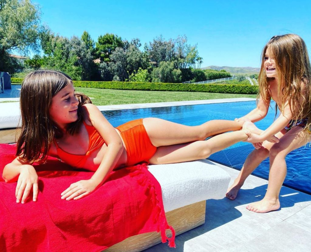 Penelope and Reign Disick Poolside