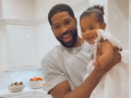 Tristan Thompson Laughs and Holds Daughter True in White Dress on Birthday