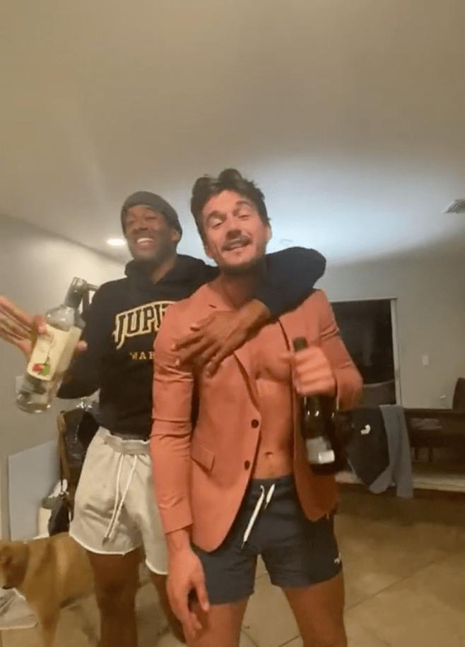 Tyler Cameron Sings Karaoke Into Wine Bottles With Matt James