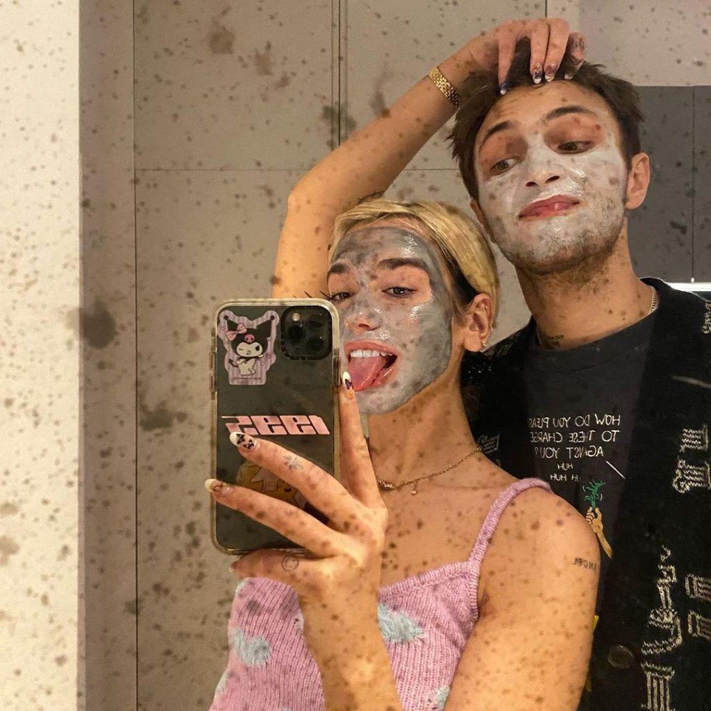 Dua Lipa Sticks Her Tongue Out Whiel Wearing a Face mask with Boyfriend Anwar Hadid